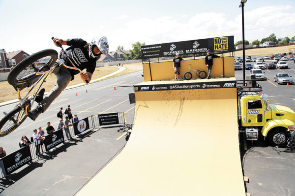 Alex Landeros warms up on the half-pipe while students at Standley Lake High School make their way to the parking lot for the presentation.