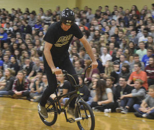 Photo by Jessica Campbell. An ASA Entertainment rider performs tricks to show the students at New Prairie High School on Thursday. The riders came to the school for an anti-bullying event.