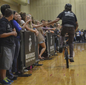 New Prairie High School students high-five the biker during the anti-bullying event on Thursday.